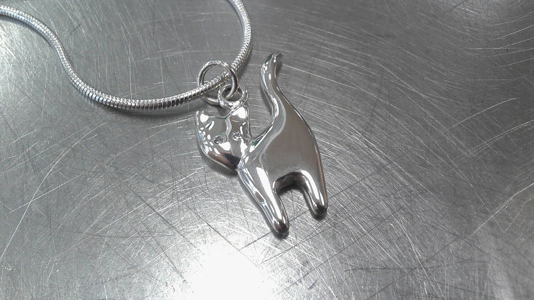 21_ujo_rocks_handmade_sterling_silver_cat_pendant_with_diamond_eyes_polished