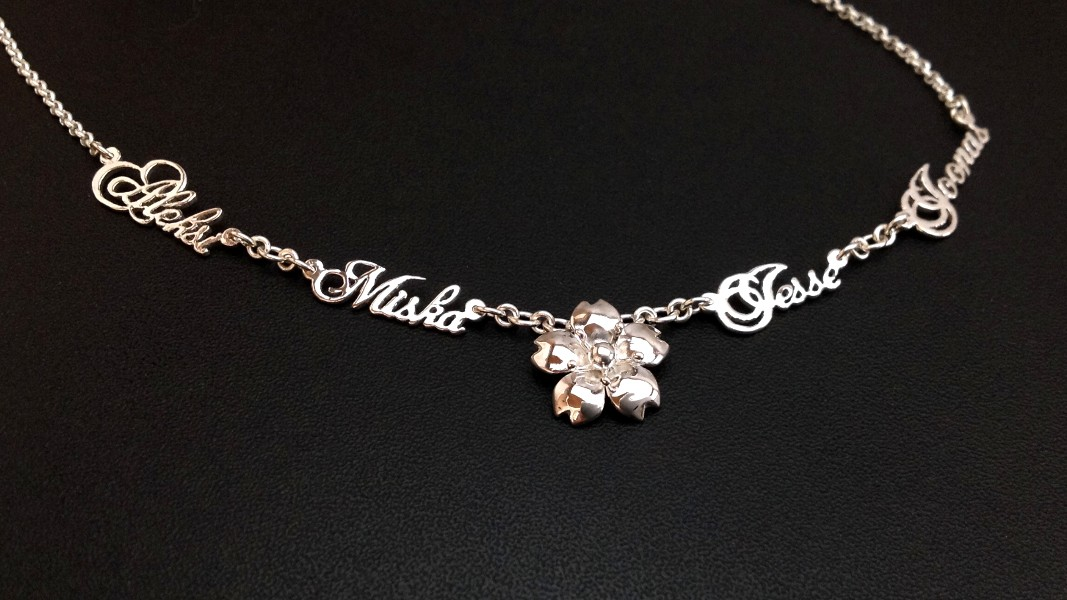 33_ujo_rocks_bespoke_handmade_sterling_silver_necklace_with_cherry_blossom_flower_and_names_of_her_four_sons